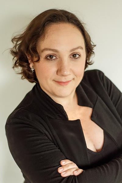 Emily Schneider<br>Creative Services Manager</br>